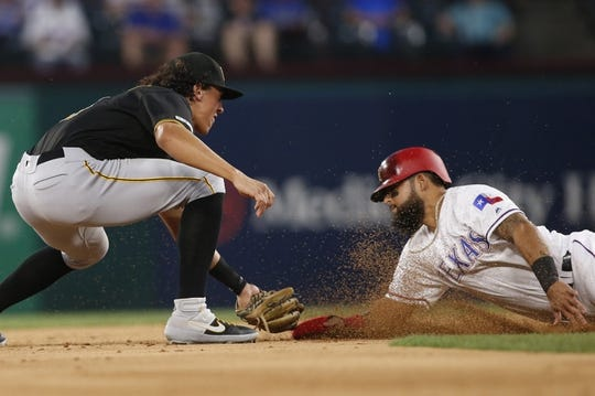 Apr 30, 2019; Arlington, TX, USA; Pittsburgh Pirates shortstop Cole Tucker (3) tags out Texas Rangers second baseman Rougned Odor (12) attempting to steal second base in the first inning at Globe Life Park in Arlington.  Mandatory Credit: Tim Heitman-USA TODAY Sports