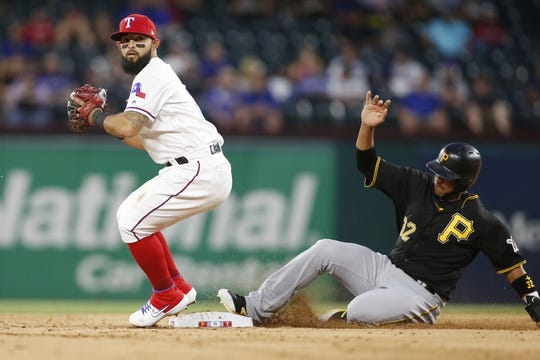 Apr 30, 2019; Arlington, TX, USA; Texas Rangers second baseman Rougned Odor (12) forces out Pittsburgh Pirates catcher Elias Diaz (32) at second base in the second inning at Globe Life Park in Arlington. Mandatory Credit: Tim Heitman-USA TODAY Sports