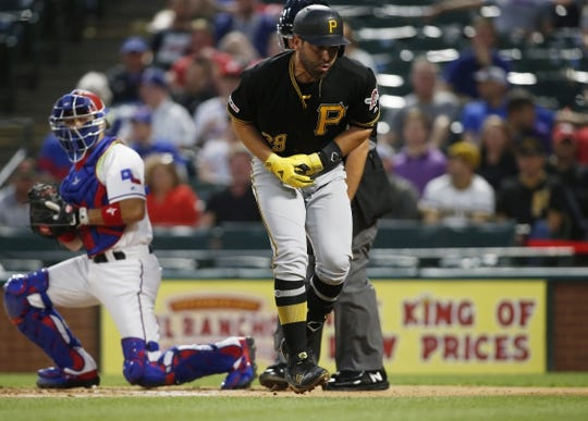 Apr 30, 2019; Arlington, TX, USA;  Pittsburgh Pirates catcher Francisco Cervelli (29) reacts to being hit by a pitch in the second inning against the Texas Rangers at Globe Life Park in Arlington. Mandatory Credit: Tim Heitman-USA TODAY Sports