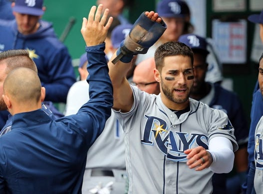 May 1, 2019; Kansas City, MO, USA; Tampa Bay Rays center fielder Kevin Kiermaier (39) is congratulated after scoring against the Kansas City Royals in the second inning in the first game of a baseball doubleheader at Kauffman Stadium. Mandatory Credit: Jay Biggerstaff-USA TODAY Sports