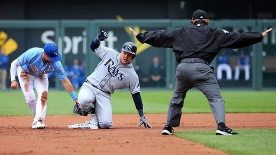 May 1, 2019; Kansas City, MO, USA; Tampa Bay Rays right fielder Avisail Garcis (24) slides into second base ahead of the tag by Kansas City Royals right fielder Whit Merrifield (15) in the second in the first game of a baseball doubleheader at Kauffman Stadium. Mandatory Credit: Jay Biggerstaff-USA TODAY Sports