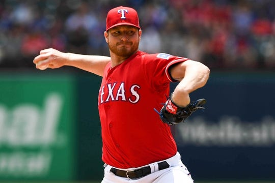 May 1, 2019; Arlington, TX, USA; Texas Rangers starting pitcher Shelby Miller (19) delivers during the first inning against the Pittsburgh Pirates at Globe Life Park in Arlington. Mandatory Credit: Shanna Lockwood-USA TODAY Sports
