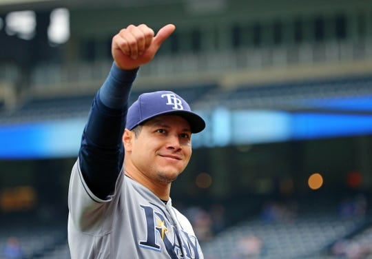 May 1, 2019; Kansas City, MO, USA; Tampa Bay Rays right fielder Avisail Garcis (24) signals to a fan during the sixth inning against the Kansas City Royals in the first game of a baseball doubleheader at Kauffman Stadium. Mandatory Credit: Jay Biggerstaff-USA TODAY Sports