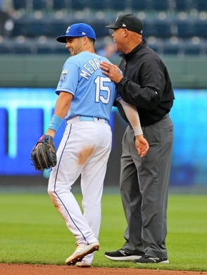 May 1, 2019; Kansas City, MO, USA; Kansas City Royals right fielder Whit Merrifield (15) talks with umpire Kerwin Danley during the ninth inning against the Tampa Bay Rays in the first game of a baseball doubleheader at Kauffman Stadium. Mandatory Credit: Jay Biggerstaff-USA TODAY Sports