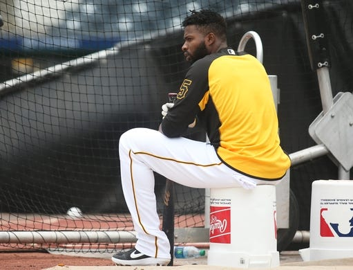 May 4, 2019; Pittsburgh, PA, USA;  Pittsburgh Pirates right fielder Gregory Polanco (25) looks on at the batting cage before playing the Oakland Athletics at PNC Park. Mandatory Credit: Charles LeClaire-USA TODAY Sports