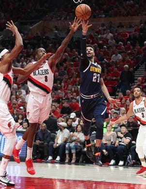 May 5, 2019; Portland, OR, USA; Denver Nuggets guard Jamal Murray (27) scores against Portland Trail Blazers forward Al-Farouq Aminu (8) in the first half of game four of the second round of the 2019 NBA Playoffs at Moda Center. Mandatory Credit: Jaime Valdez-USA TODAY Sports
