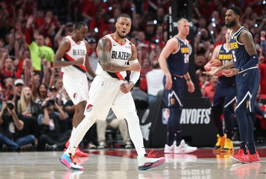 May 5, 2019; Portland, OR, USA; Portland Trail Blazers guard Damian Lillard (0) reacts after hitting a three-point basket against the Denver Nuggets in the first half of game four of the second round of the 2019 NBA Playoffs at Moda Center. Mandatory Credit: Jaime Valdez-USA TODAY Sports