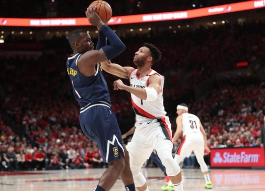 May 5, 2019; Portland, OR, USA; Denver Nuggets forward Paul Millsap (4) controls the ball against Portland Trail Blazers guard Evan Turner (1) in the first half of game four of the second round of the 2019 NBA Playoffs at Moda Center. Mandatory Credit: Jaime Valdez-USA TODAY Sports