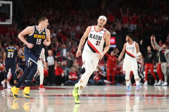 May 5, 2019; Portland, OR, USA; Portland Trail Blazers guard Seth Curry (31) reacts after scoring over Denver Nuggets center Nikola Jokic (15) in the first half of game four of the second round of the 2019 NBA Playoffs at Moda Center. Mandatory Credit: Jaime Valdez-USA TODAY Sports