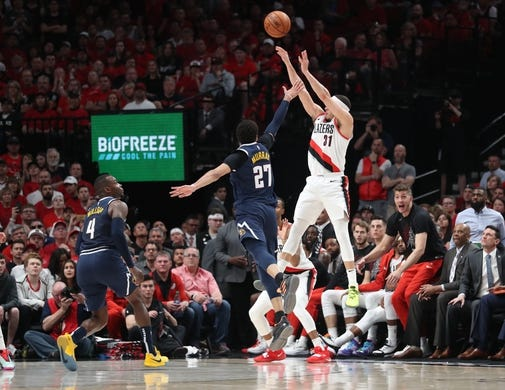 May 5, 2019; Portland, OR, USA; Portland Trail Blazers guard Seth Curry (31) scores a three-point basket before time expires in the first half against the Denver Nuggets during game four of the second round of the 2019 NBA Playoffs at Moda Center. Mandatory Credit: Jaime Valdez-USA TODAY Sports