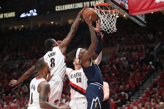 May 5, 2019; Portland, OR, USA; Portland Trail Blazers forward Al-Farouq Aminu (8) blocks a shot by Denver Nuggets forward Torrey Craig (3) in the first half of game four of the second round of the 2019 NBA Playoffs at Moda Center. Mandatory Credit: Jaime Valdez-USA TODAY Sports