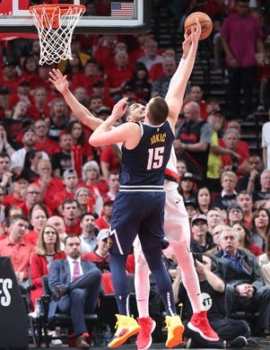 May 5, 2019; Portland, OR, USA; Portland Trail Blazers center Enes Kanter (00) blocks a shot by Denver Nuggets center Nikola Jokic (15) in the second half of game four of the second round of the 2019 NBA Playoffs at Moda Center. Mandatory Credit: Jaime Valdez-USA TODAY Sports