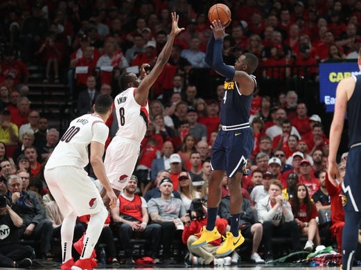 May 5, 2019; Portland, OR, USA; Denver Nuggets forward Paul Millsap (4) shoots over Portland Trail Blazers forward Al-Farouq Aminu (8) in the second half of game four of the second round of the 2019 NBA Playoffs at Moda Center. Mandatory Credit: Jaime Valdez-USA TODAY Sports