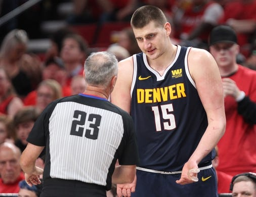 May 5, 2019; Portland, OR, USA; Denver Nuggets center Nikola Jokic (15) pleads his case to referee Jason Phillips (23) in the second half of game four of the second round of the 2019 NBA Playoffs against the Portland Trail Blazers at Moda Center. Mandatory Credit: Jaime Valdez-USA TODAY Sports