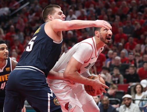 May 5, 2019; Portland, OR, USA; Denver Nuggets center Nikola Jokic (15) pressures Portland Trail Blazers center Enes Kanter (00) in the second half of game four of the second round of the 2019 NBA Playoffs at Moda Center. Mandatory Credit: Jaime Valdez-USA TODAY Sports