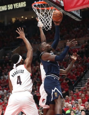 May 5, 2019; Portland, OR, USA; Denver Nuggets forward Paul Millsap (4) scores over Portland Trail Blazers forward Maurice Harkless (4) in the first half of game four of the second round of the 2019 NBA Playoffs at Moda Center. Mandatory Credit: Jaime Valdez-USA TODAY Sports