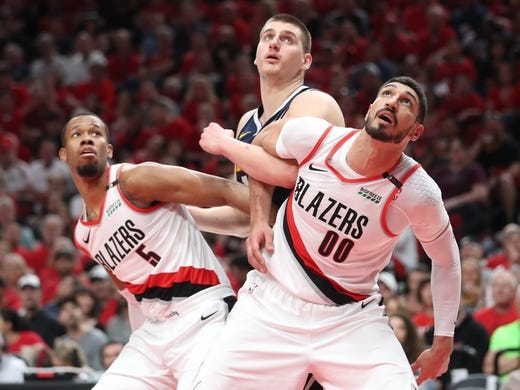 May 5, 2019; Portland, OR, USA; Portland Trail Blazers guard Rodney Hood (5) and center Enes Kanter (00) block out Denver Nuggets center Nikola Jokic (15) during a free throw in the first half of game four of the second round of the 2019 NBA Playoffs at Moda Center. Mandatory Credit: Jaime Valdez-USA TODAY Sports