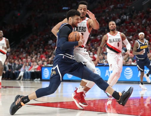 May 5, 2019; Portland, OR, USA; Denver Nuggets guard Jamal Murray (27) drives against Portland Trail Blazers guard CJ McCollum (3) in the first half of game four of the second round of the 2019 NBA Playoffs at Moda Center. Mandatory Credit: Jaime Valdez-USA TODAY Sports