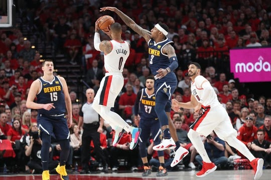 May 5, 2019; Portland, OR, USA; Portland Trail Blazers guard Damian Lillard (0) shoots against Denver Nuggets forward Torrey Craig (3) in the first half of game four of the second round of the 2019 NBA Playoffs at Moda Center. Mandatory Credit: Jaime Valdez-USA TODAY Sports