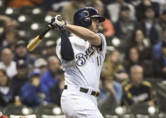 May 6, 2019; Milwaukee, WI, USA; Milwaukee Brewers second baseman Mike Moustakas (11) drives in a run with a base hit in the first inning against the Washington Nationals at Miller Park. Mandatory Credit: Benny Sieu-USA TODAY Sports