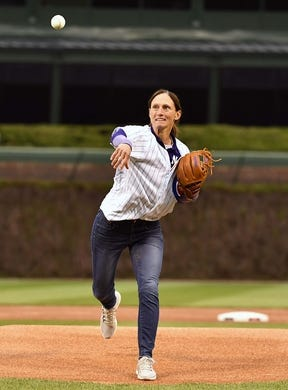 May 6, 2019; Chicago, IL, USA; Northwestern University Wildcats head softball coach Kate Drohan throws the ceremonial first pitch before the game between the Chicago Cubs and the Miami Marlins at Wrigley Field. Mandatory Credit: Quinn Harris-USA TODAY Sports