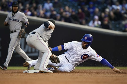 May 6, 2019; Chicago, IL, USA; Chicago Cubs catcher Willson Contreras (40) advances to second base in the first inning against the Miami Marlins at Wrigley Field. Mandatory Credit: Quinn Harris-USA TODAY Sports