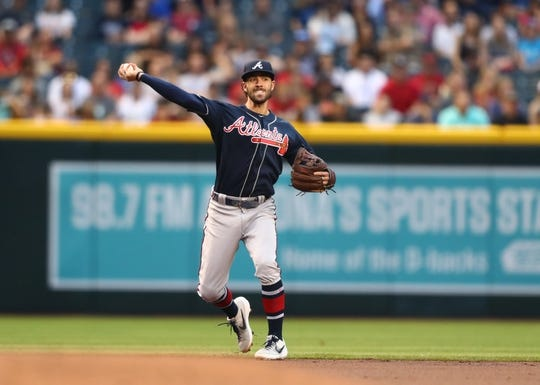 May 9, 2019; Phoenix, AZ, USA; Atlanta Braves shortstop Dansby Swanson throws to first base for an out in the first inning against the Arizona Diamondbacks at Chase Field. Mandatory Credit: Mark J. Rebilas-USA TODAY Sports