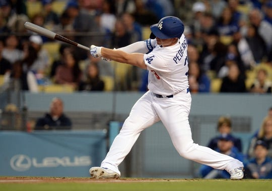 May 10, 2019; Los Angeles, CA, USA; Los Angeles Dodgers left fielder Joc Pederson (31) hits a solo home run against the Washington Nationals during the first inning at Dodger Stadium. Mandatory Credit: Gary A. Vasquez-USA TODAY Sports