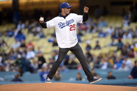 May 10, 2019; Los Angeles, CA, USA; PGA golfer Max Home throws the ceremony first pitch at Dodger Stadium. Mandatory Credit: Gary A. Vasquez-USA TODAY Sports