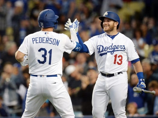 May 10, 2019; Los Angeles, CA, USA; Los Angeles Dodgers left fielder Joc Pederson (31) is greeted by third baseman Max Muncy (13) after hitting a solo home run against the Washington Nationals during the first inning at Dodger Stadium. Mandatory Credit: Gary A. Vasquez-USA TODAY Sports