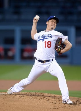 May 10, 2019; Los Angeles, CA, USA; Los Angeles Dodgers starting pitcher Kenta Maeda (18) throws against the Washington Nationals during the second inning at Dodger Stadium. Mandatory Credit: Gary A. Vasquez-USA TODAY Sports