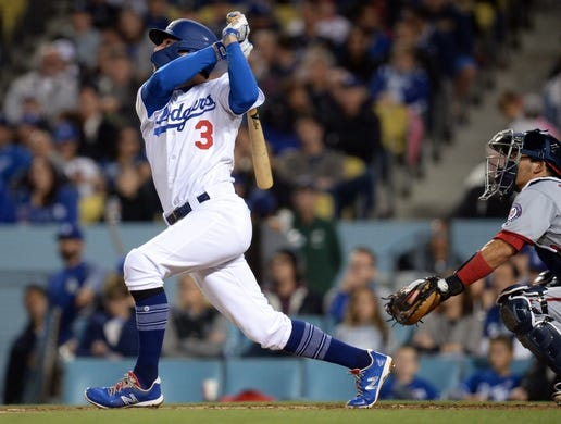 May 10, 2019; Los Angeles, CA, USA; Los Angeles Dodgers shortstop Chris Taylor (3) hits an RBI triple against the Washington Nationals during the fourth inning at Dodger Stadium. Mandatory Credit: Gary A. Vasquez-USA TODAY Sports