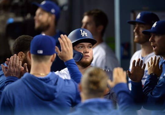May 10, 2019; Los Angeles, CA, USA; Los Angeles Dodgers center fielder Alex Verdugo (27) is greeted after scoring a run against the Washington Nationals during the fourth inning at Dodger Stadium. Mandatory Credit: Gary A. Vasquez-USA TODAY Sports