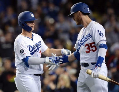 May 10, 2019; Los Angeles, CA, USA; Los Angeles Dodgers left fielder Joc Pederson (31) celebrates with right fielder Cody Bellinger (35) his solo home run against the Washington Nationals during the fifth inning at Dodger Stadium. Mandatory Credit: Gary A. Vasquez-USA TODAY Sports