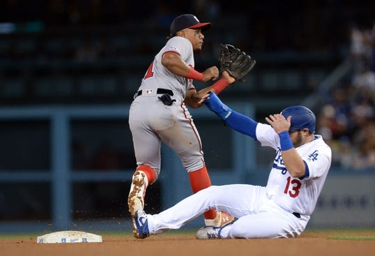 May 10, 2019; Los Angeles, CA, USA; Los Angeles Dodgers third baseman Max Muncy (13) steals second ahead of Washington Nationals shortstop Wilmer Difo (1) during the fifth inning at Dodger Stadium. Mandatory Credit: Gary A. Vasquez-USA TODAY Sports