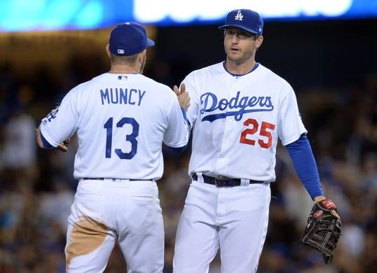 May 10, 2019; Los Angeles, CA, USA; Los Angeles Dodgers third baseman Max Muncy (13) and first baseman David Freese (25) celebrate the 5-0 victory against the Washington Nationals at Dodger Stadium. Mandatory Credit: Gary A. Vasquez-USA TODAY Sports