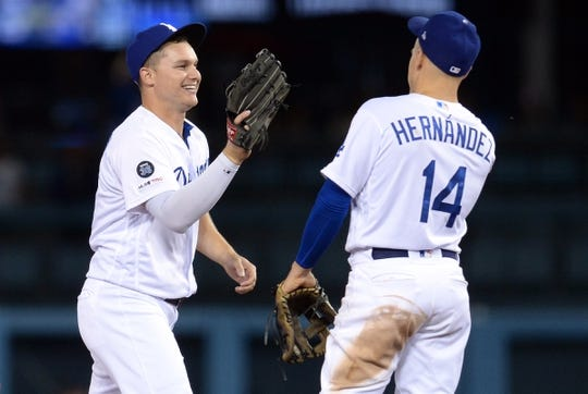 May 10, 2019; Los Angeles, CA, USA; Los Angeles Dodgers left fielder Joc Pederson (31) and infielder Enrique Hernandez (14) celebrate the 5-0 victory against the Washington Nationals at Dodger Stadium. Mandatory Credit: Gary A. Vasquez-USA TODAY Sports