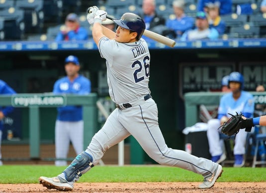 May 1, 2019; Kansas City, MO, USA; Tampa Bay Rays first baseman Ji-Man Choi (26) bats against the Kansas City Royals in the first game of a baseball doubleheader at Kauffman Stadium. Mandatory Credit: Jay Biggerstaff-USA TODAY Sports