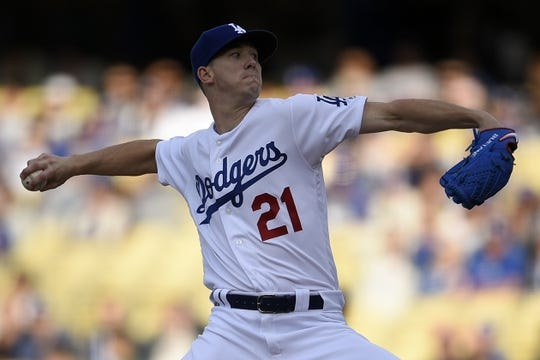 May 11, 2019; Los Angeles, CA, USA; Los Angeles Dodgers starting pitcher Walker Buehler (21) pitches during the first inning against the Washington Nationals at Dodger Stadium. Mandatory Credit: Kelvin Kuo-USA TODAY Sports