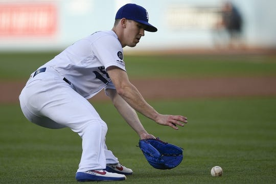 May 11, 2019; Los Angeles, CA, USA; Los Angeles Dodgers starting pitcher Walker Buehler (21) fields an infield ground ball during the first inning against the Washington Nationals at Dodger Stadium. Mandatory Credit: Kelvin Kuo-USA TODAY Sports