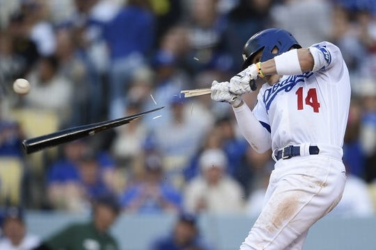 iMay 11, 2019; Los Angeles, CA, USA; Los Angeles Dodgers second baseman Enrique Hernandez (14) breaks his bat while hitting into a double play during the second inning against the Washington Nationals at Dodger Stadium. Mandatory Credit: Kelvin Kuo-USA TODAY Sports