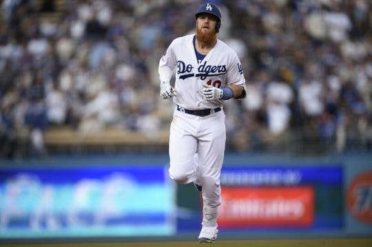 May 11, 2019; Los Angeles, CA, USA; Los Angeles Dodgers third baseman Justin Turner (10) rounds the bases after hitting a two-run home run during the third inning against the Washington Nationals at Dodger Stadium. Mandatory Credit: Kelvin Kuo-USA TODAY Sports