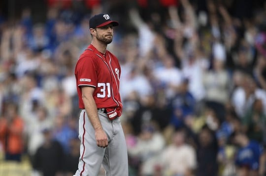 May 11, 2019; Los Angeles, CA, USA; Washington Nationals starting pitcher Max Scherzer (31) reacts after giving up a two-run home run to Los Angeles Dodgers third baseman Justin Turner (not pictured) during the third inning at Dodger Stadium. Mandatory Credit: Kelvin Kuo-USA TODAY Sports