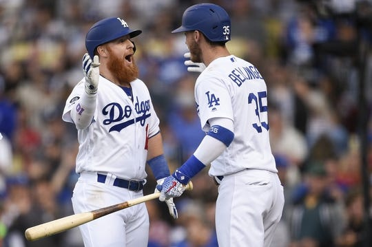 May 11, 2019; Los Angeles, CA, USA;Los Angeles Dodgers third baseman Justin Turner (10) celebrates with right fielder Cody Bellinger (35) after hitting a two-run home run during the third inning against the Washington Nationals at Dodger Stadium. Mandatory Credit: Kelvin Kuo-USA TODAY Sports