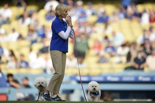May 11, 2019; Los Angeles, CA, USA; UCLA People-Animal Connection volunteer handler Donna throws out te first pitch alongside therapy dogs Finley and Tommy prior to the game between the Los Angeles Dodgers and Washington Nationals during the first inning at Dodger Stadium. Mandatory Credit: Kelvin Kuo-USA TODAY Sports