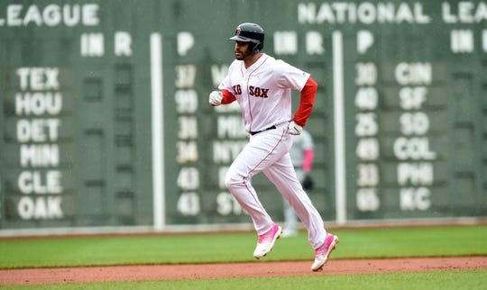 May 12, 2019; Boston, MA, USA; Boston Red Sox right fielder J.D. Martinez (28) rounds the bases after hitting a home run during the first inning against the Seattle Mariners at Fenway Park. Mandatory Credit: Bob DeChiara-USA TODAY Sports