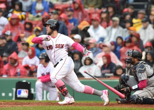May 12, 2019; Boston, MA, USA; Boston Red Sox second baseman Michael Chavis (23) hits an RBI single during the fifth inning against the Seattle Mariners at Fenway Park. Mandatory Credit: Bob DeChiara-USA TODAY Sports