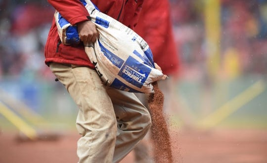 May 12, 2019; Boston, MA, USA; A member of the Boston Red Sox grounds crew prepares the infield during the fifth inning against the Seattle Mariners at Fenway Park. Mandatory Credit: Bob DeChiara-USA TODAY Sports