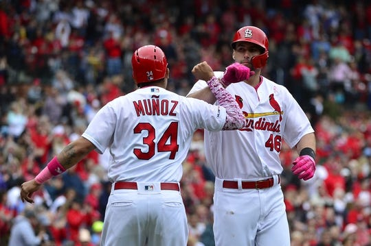 May 12, 2019; St. Louis, MO, USA; St. Louis Cardinals first baseman Paul Goldschmidt (46) is celebrates with center fielder Yairo Munoz (34) after hitting a two run home run off of Pittsburgh Pirates starting pitcher Steven Brault (not pictured) during the first inning at Busch Stadium. Mandatory Credit: Jeff Curry-USA TODAY Sports