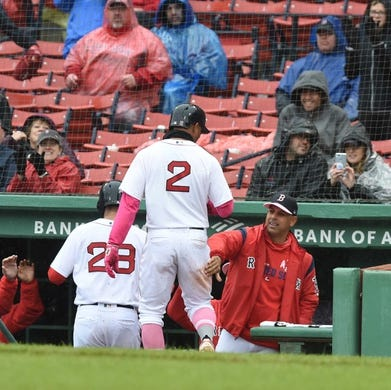 May 12, 2019; Boston, MA, USA; Boston Red Sox shortstop Xander Bogaerts (2) is greeted in the dugout after scoring a run during the seventh inning against the Seattle Mariners at Fenway Park. Mandatory Credit: Bob DeChiara-USA TODAY Sports
